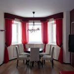 Красные шторы с отделкой